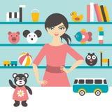 Donna di vendite dei depositi di giocattolo Fotografia Stock