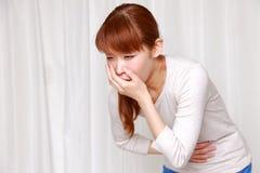 Donna di vomito Fotografia Stock