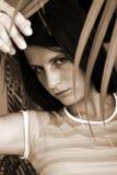 Donna dietro il foglio Fotografia Stock