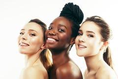Donna differente di nazione tre: afroamericano, togeth caucasico fotografia stock