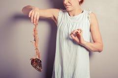 Donna disgustata con lo scheletro del pesce Fotografia Stock Libera da Diritti