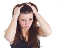 Donna Displeased con le mani in capelli immagini stock