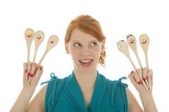 Donna divertente con i cucchiai Immagini Stock