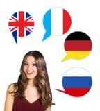 Donna e bolle con le bandiere di paesi Fotografia Stock