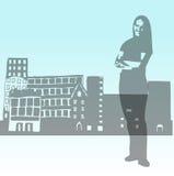 Donna e città Fotografia Stock