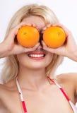 Donna e dieta arancione fotografia stock libera da diritti