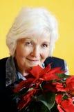 Donna e fiore maggiori Fotografia Stock Libera da Diritti