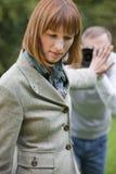 Donna e fotografo Fotografia Stock
