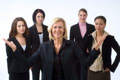 Donna e la sua squadra Fotografie Stock Libere da Diritti