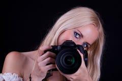 Donna e macchina fotografica Fotografie Stock