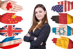 Donna e molte mani con differenti bandiere Fotografie Stock Libere da Diritti