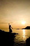 Donna e tramonto Immagine Stock