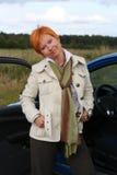 Donna e un'automobile Fotografia Stock