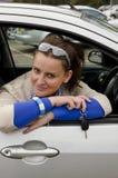 Donna ed automobile Fotografia Stock