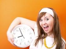 Donna ed orologio Fotografia Stock Libera da Diritti