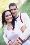 Donna ed uomo con il nastro rosa per la guarigione il giorno del cancro del mondo fotografia stock libera da diritti