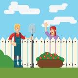 Donna ed uomo vicino al wicket del recinto in giardino Immagini Stock