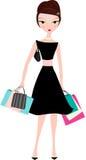 Donna elegante con i sacchetti di acquisto Fotografia Stock Libera da Diritti