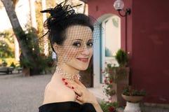 Donna elegante con il cappello Immagini Stock