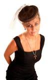 Donna elegante con un velare sulla sua testa Immagini Stock