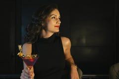 Donna elegante in un night-club Fotografia Stock