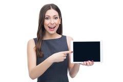Donna emozionante con la compressa digitale Fotografia Stock Libera da Diritti
