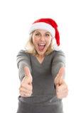 Donna emozionante di natale con i pollici in su Fotografia Stock