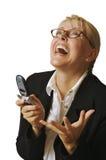 Donna esaltata che per mezzo del telefono delle cellule Immagini Stock Libere da Diritti