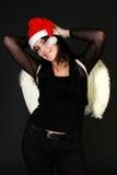 Donna felice in cappello di Santa con le ali bianche Immagini Stock