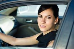 Donna felice che conduce la sua automobile Fotografia Stock Libera da Diritti