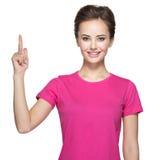 Donna felice che indica su con il suo dito Immagini Stock Libere da Diritti