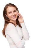 Donna felice che parla sul telefono cellulare immagine stock