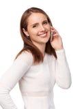 Donna felice che parla sul telefono cellulare fotografia stock