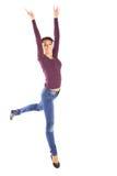 Donna felice che salta con la gioia Fotografia Stock