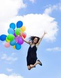 Donna felice con gli aerostati Immagine Stock