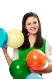 Donna felice con gli aerostati Immagini Stock