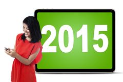 Donna felice con i numeri 2015 Fotografie Stock