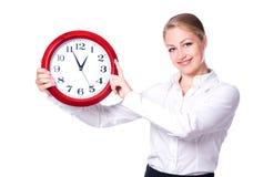 Donna felice con l'orologio Fotografie Stock Libere da Diritti
