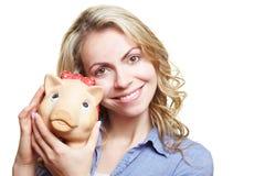 Donna felice con la banca piggy Immagine Stock Libera da Diritti