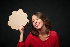 Donna felice con la bolla di pensiero Immagine Stock