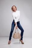 Donna felice con la borsa Immagini Stock Libere da Diritti