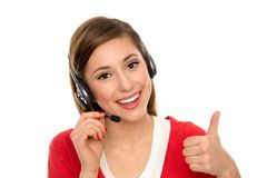Donna felice con la cuffia avricolare del telefono Immagini Stock Libere da Diritti
