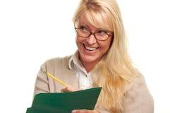 Donna felice con la matita ed il dispositivo di piegatura Fotografia Stock