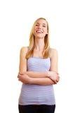 Donna felice con le braccia attraversate Fotografie Stock Libere da Diritti