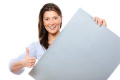 Donna felice con una bandiera Fotografie Stock