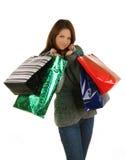 Donna felice d'acquisto. Isolato sopra il backgrou bianco Fotografia Stock