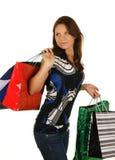 Donna felice d'acquisto. Isolato sopra il backgrou bianco Immagini Stock