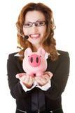 Donna felice della call center con il porcellino salvadanaio Fotografia Stock