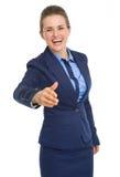 Donna felice di affari che allunga mano per la stretta di mano Fotografie Stock