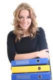 Donna felice di affari con i dispositivi di piegatura Immagine Stock Libera da Diritti